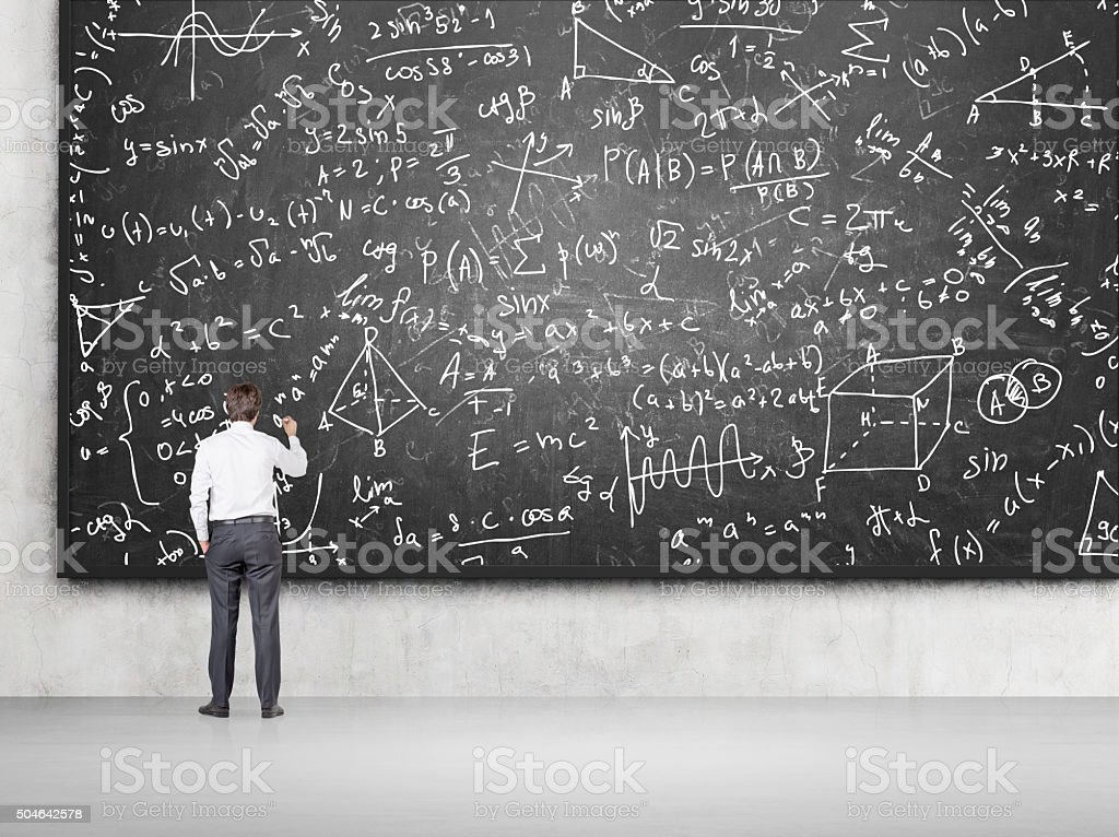 Man solving problems on blackboard stock photo