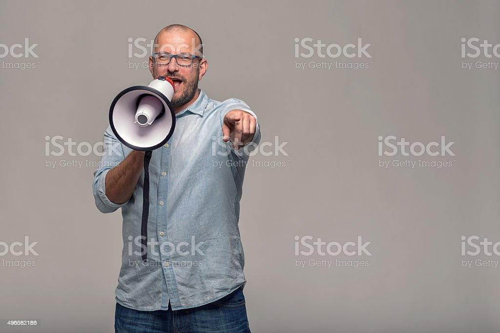 Man speaking over a megaphone stock photo