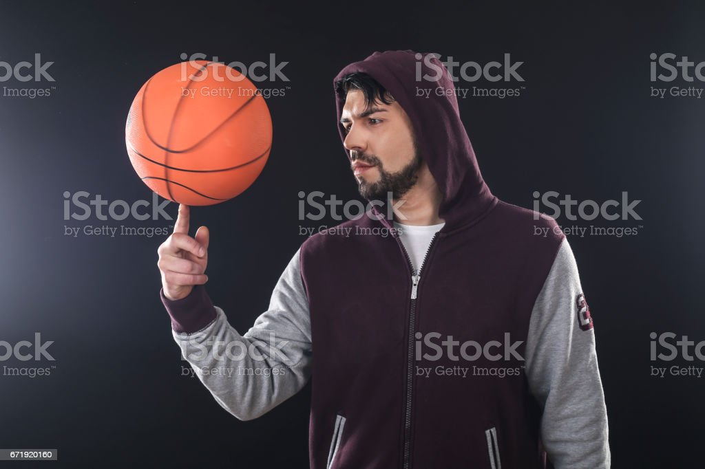 Man spinning a basketball ball stock photo