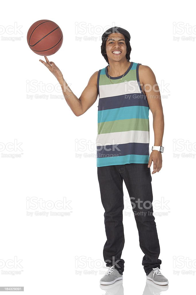 Man spinning a basketball on finger stock photo