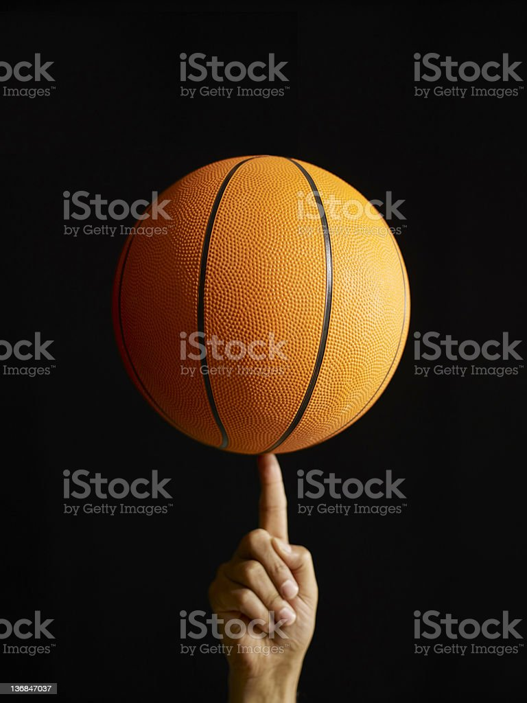 Man Spinning Basketball In Air stock photo