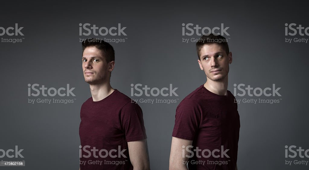 man splitting in two portrait stock photo
