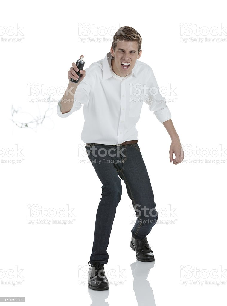 Man spraying party string from a can royalty-free stock photo