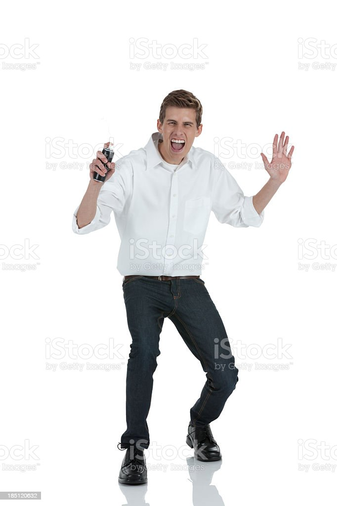 Man spraying party strings stock photo