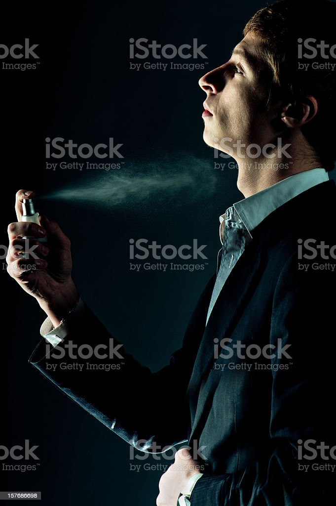 Man spraying perfume stock photo