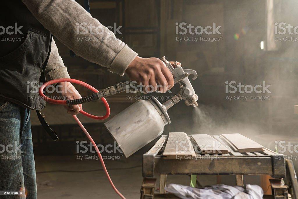 Man spraying some paint stock photo
