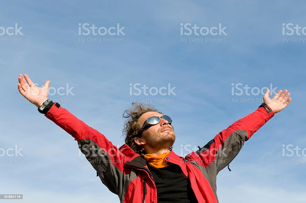 man spreading his arms wide up stock photo