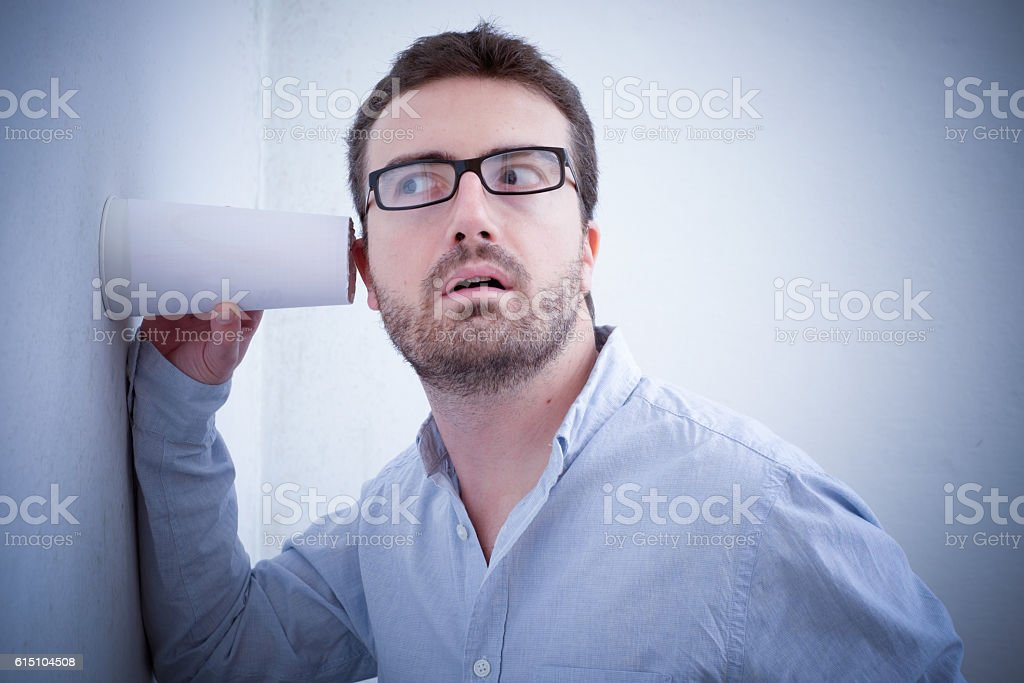 Man spying and listening a discussion stock photo