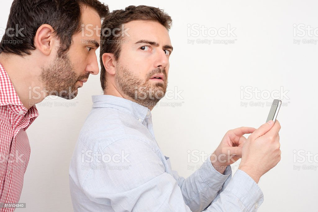 Man spying the mobile phone stock photo