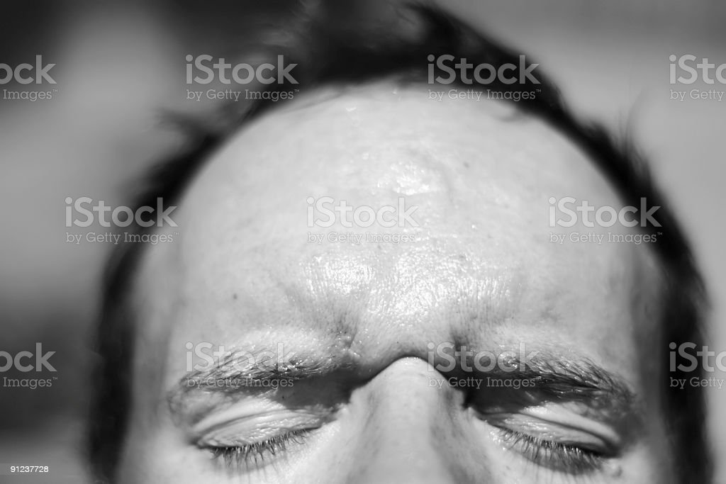 man squinting stock photo