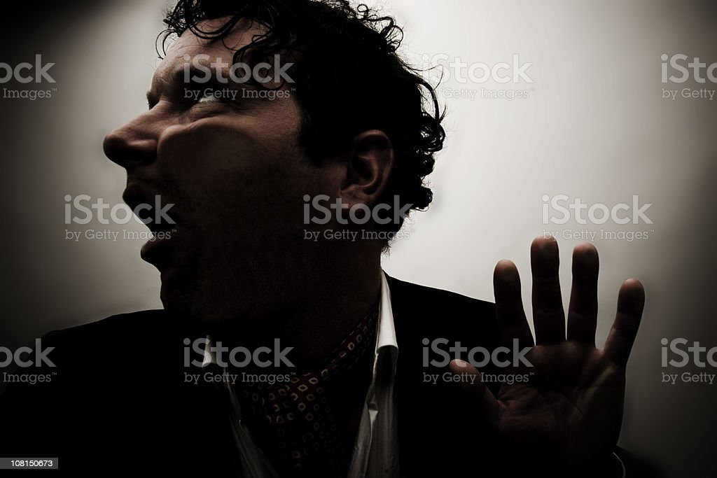 Man Squished Against Glass Pane, Low Key royalty-free stock photo