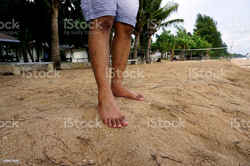 Man standing alone on the beach stock photo