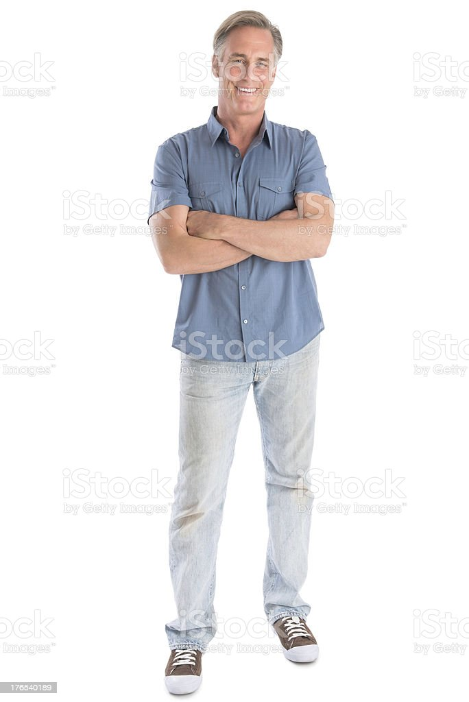 Man Standing Arms Crossed Against White Background stock photo
