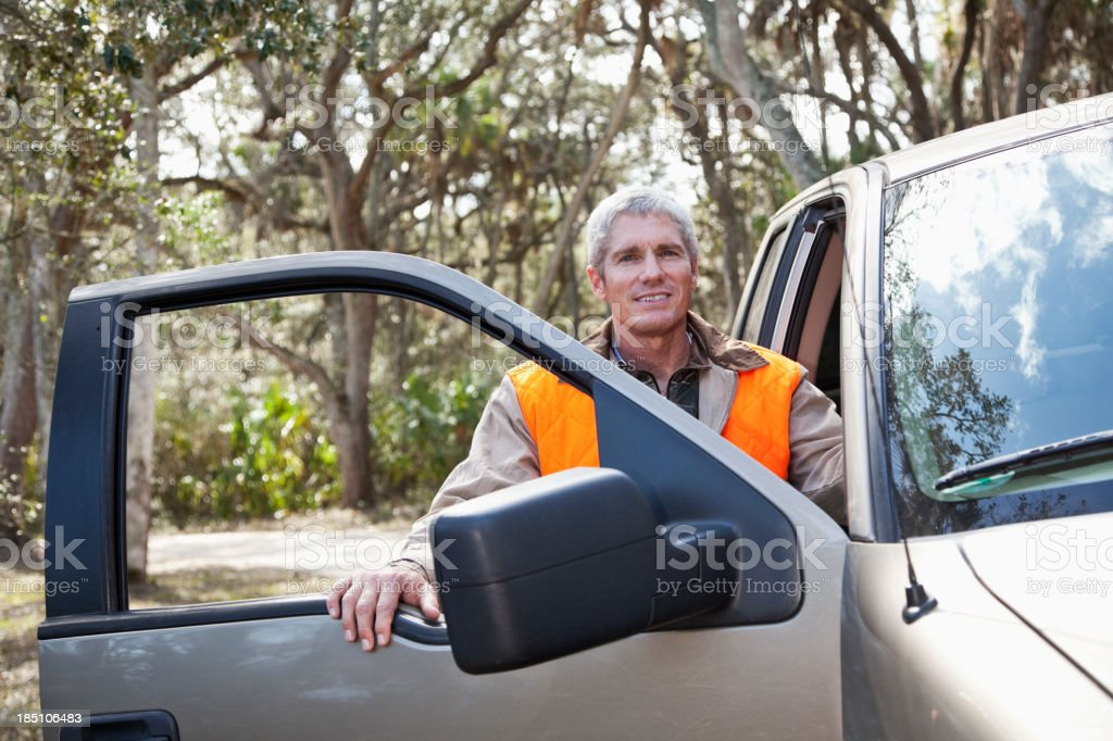Man standing at door of pickup truck royalty-free stock photo