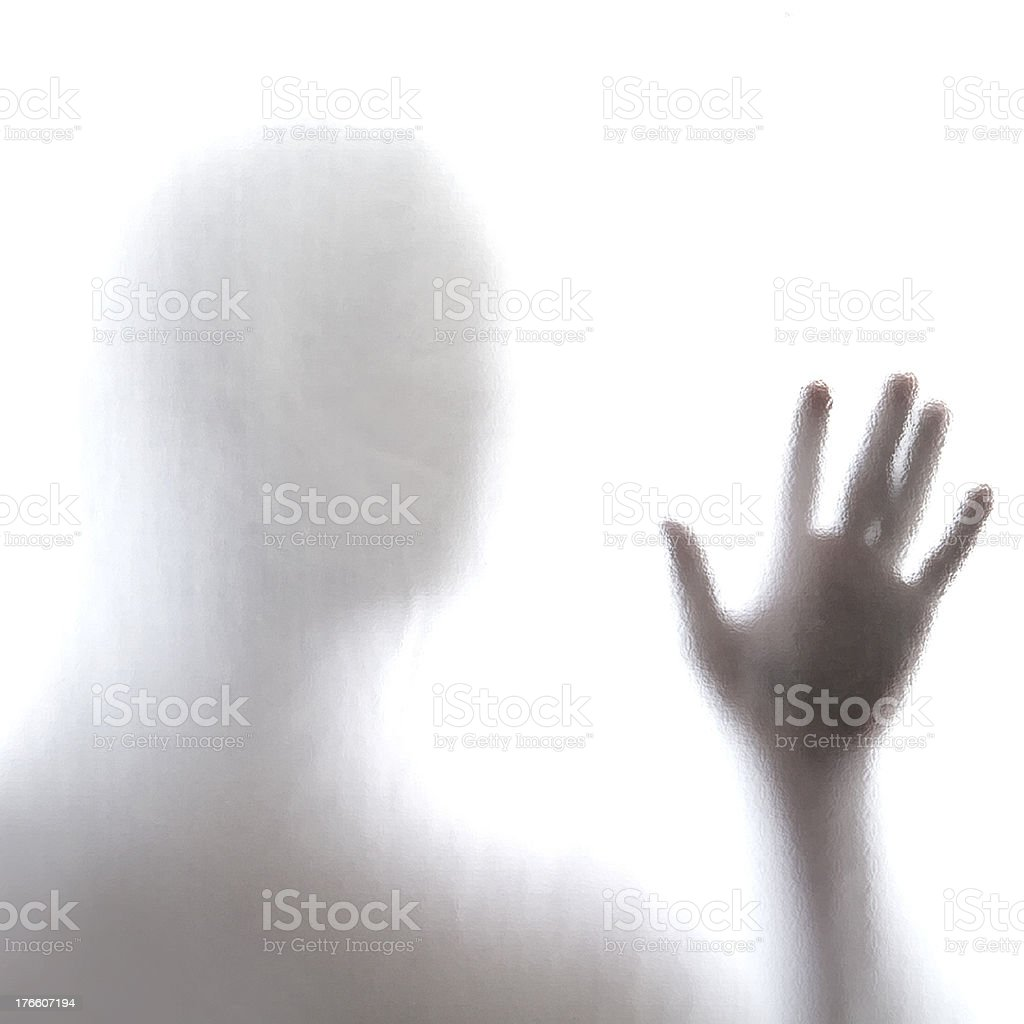 Man standing behind frosted glass royalty-free stock photo
