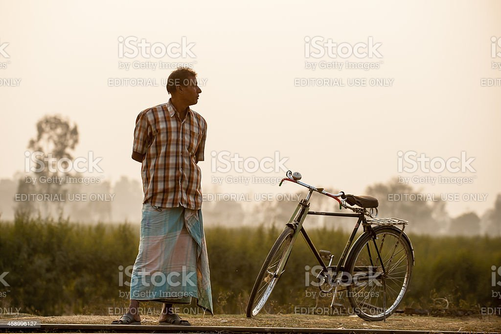 Man standing beside his bicycle, Nepal stock photo