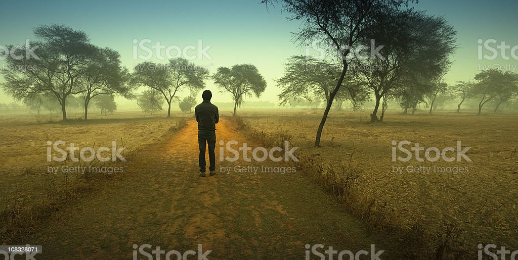 Man standing between a country road royalty-free stock photo