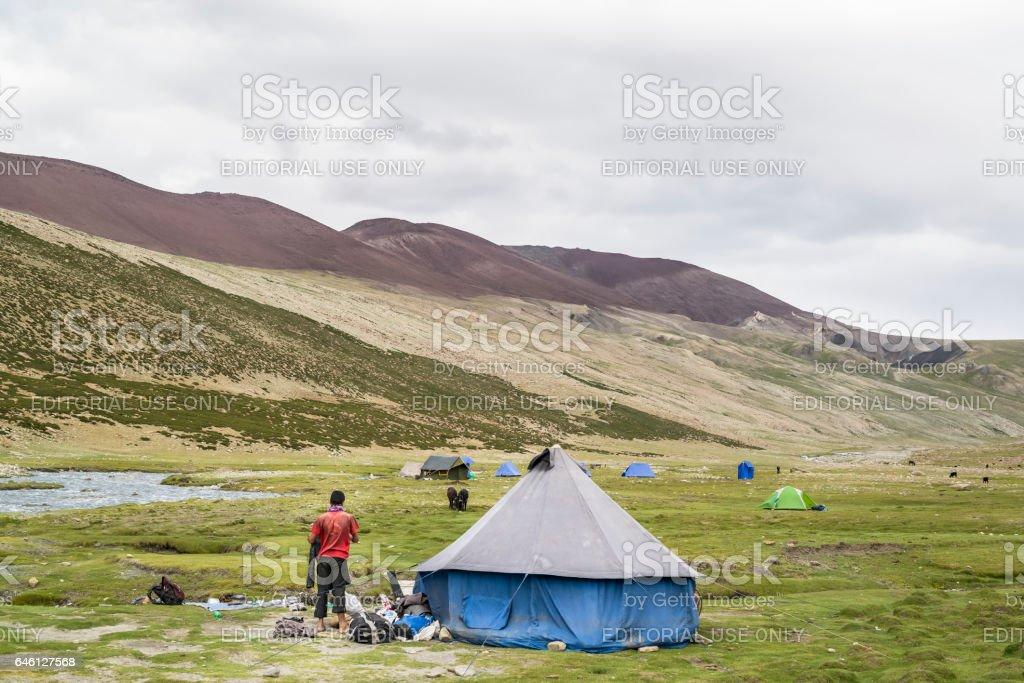 Man standing by a big blue tent at Nemaling (Ladakh) stock photo