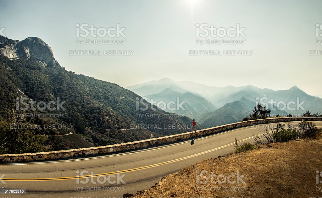 Man standing by the road stock photo