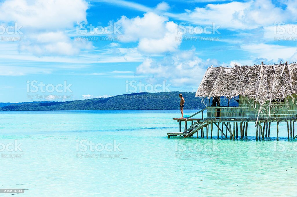 Man Standing in a Beach Hut by the Sea stock photo
