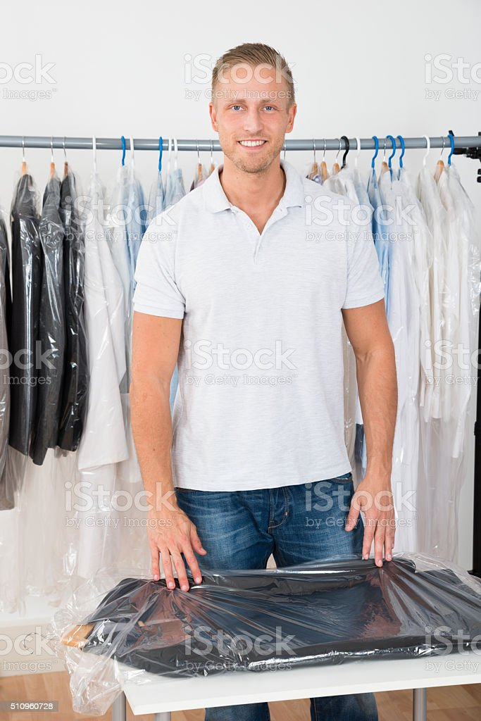 Man Standing In Clothing Store stock photo