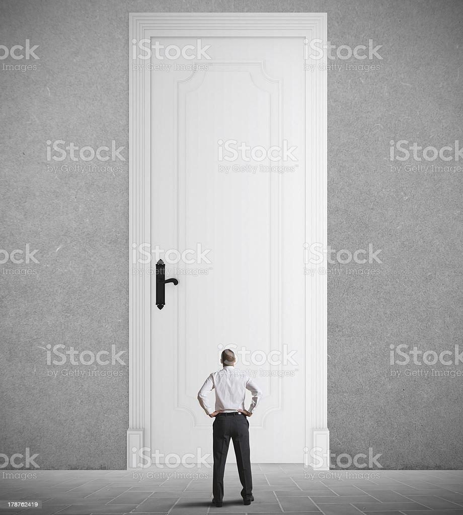 A man standing in front of a very big door stock photo