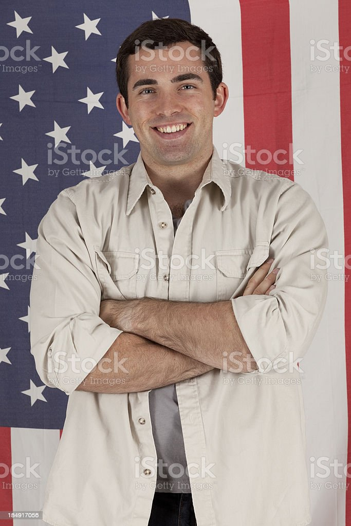 Man standing in front of an American flag royalty-free stock photo