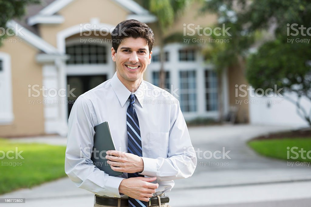 Man standing in front of house stock photo