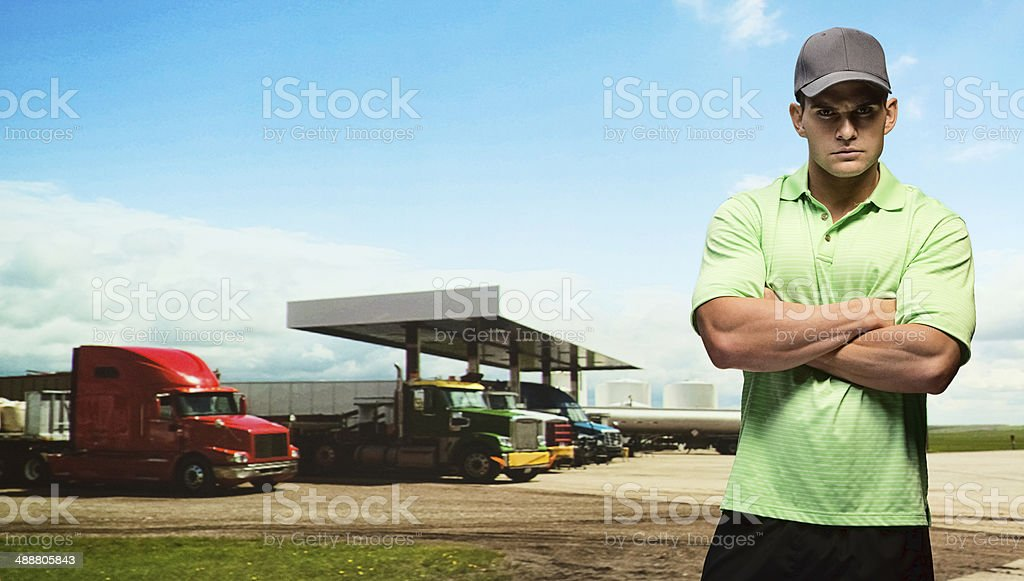 Man standing in front of petrol/gas station stock photo