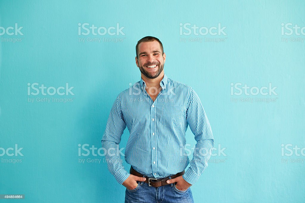 Man standing in front of wall stock photo