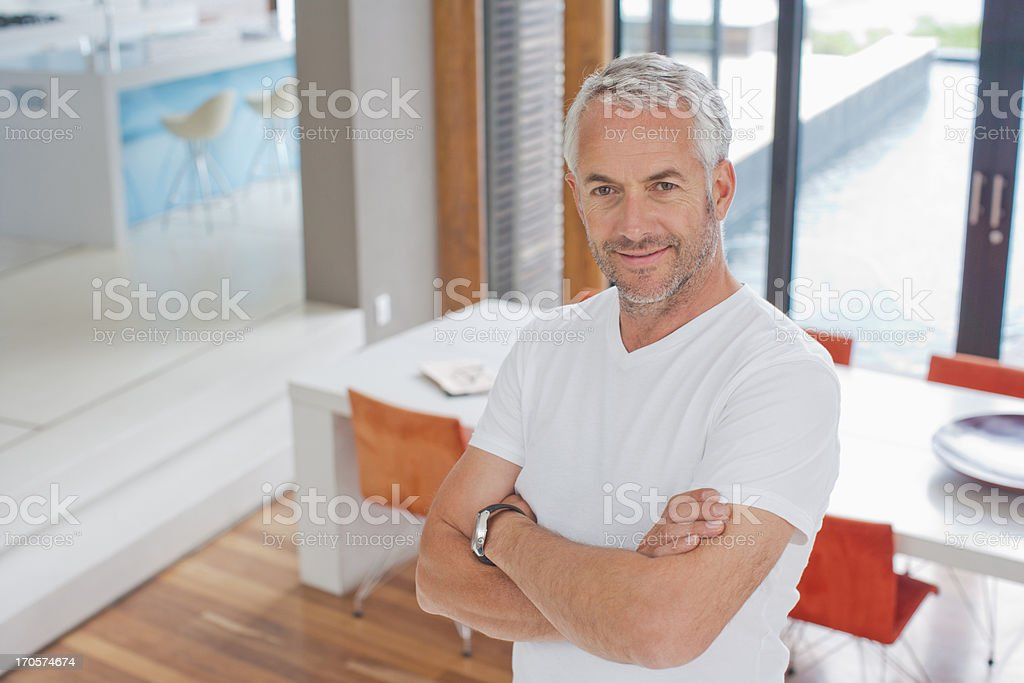 Man standing in living room royalty-free stock photo