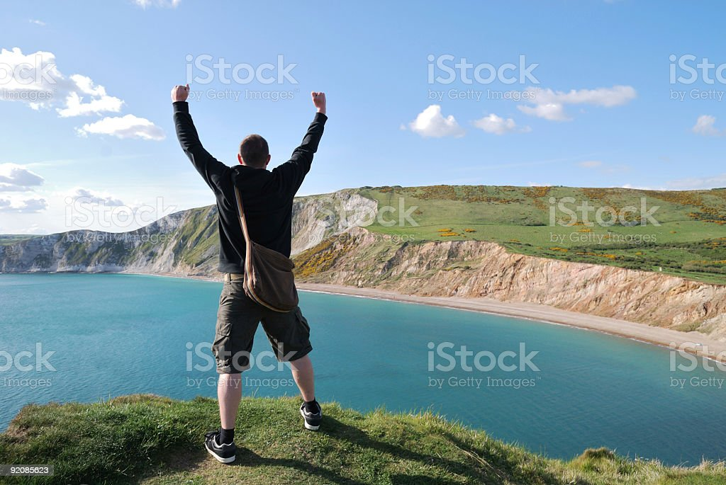Man standing in triumph on a hill royalty-free stock photo