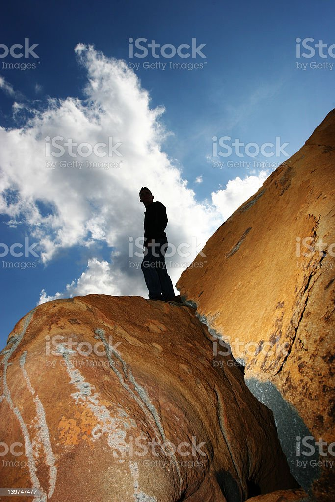 Man standing isolated against blue sky royalty-free stock photo