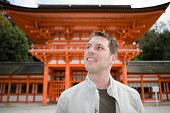 Man standing near a pagoda