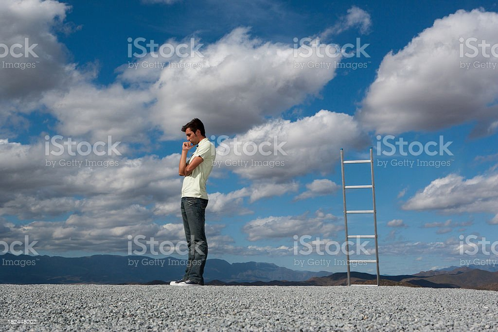 Man standing near ladder outdoors royalty-free stock photo