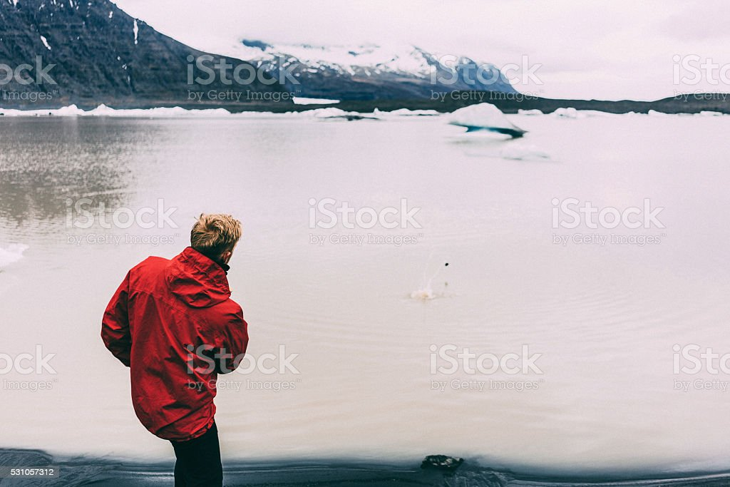 Man standing near the lake stock photo