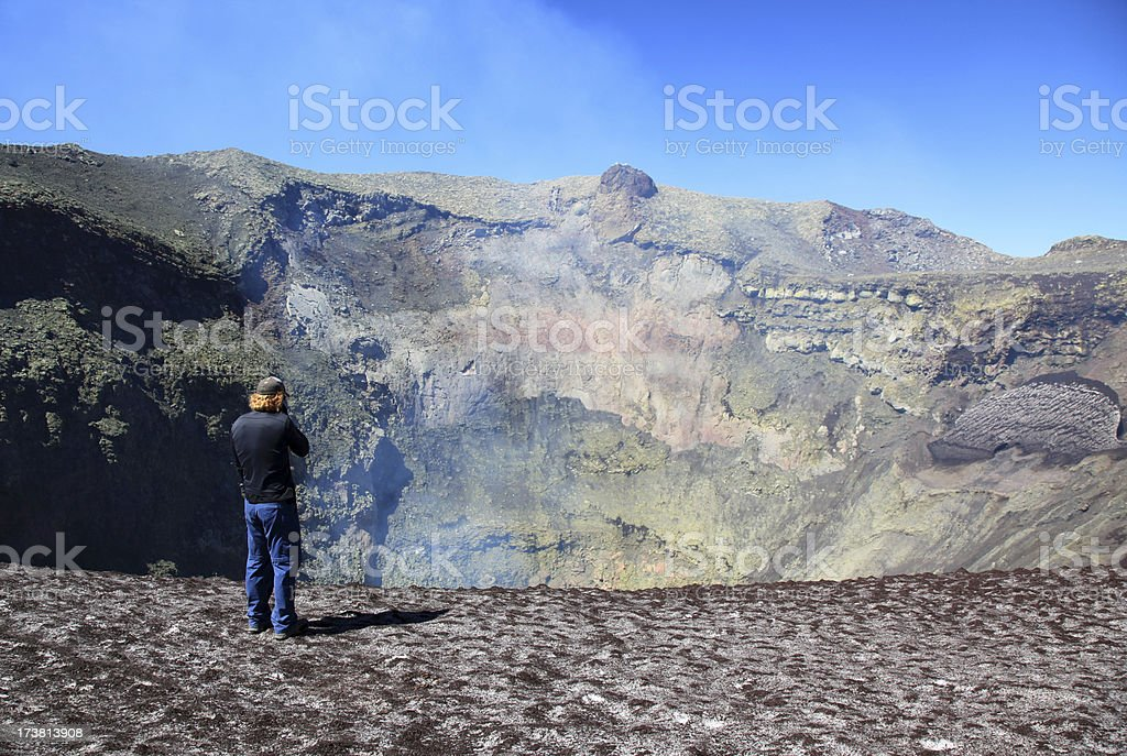 Man Standing Near the Smoking Crater of Villarrica Volcano, Chile royalty-free stock photo
