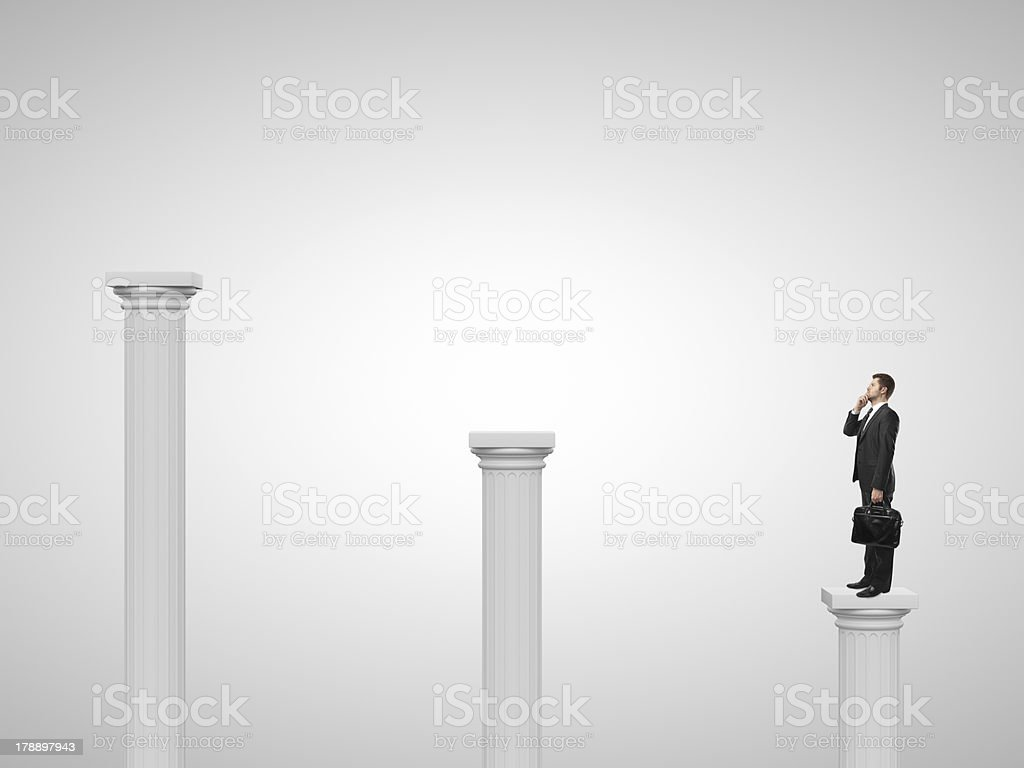 man standing on a column royalty-free stock photo