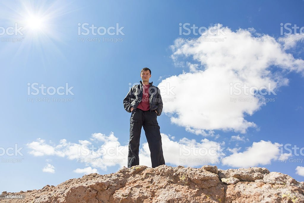 Man standing on a rock royalty-free stock photo