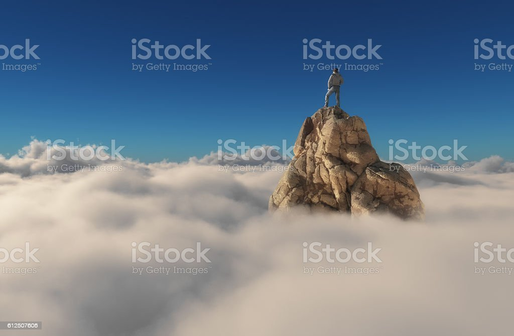 Man standing on a stone cliff stock photo
