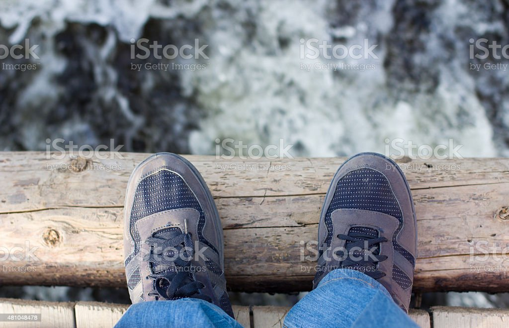 man standing on a wooden bridge royalty-free stock photo