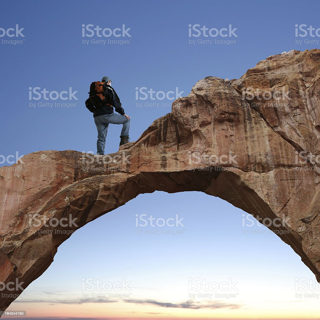 XXL man standing on arch royalty-free stock photo