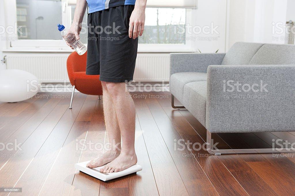 Man standing on balance stock photo