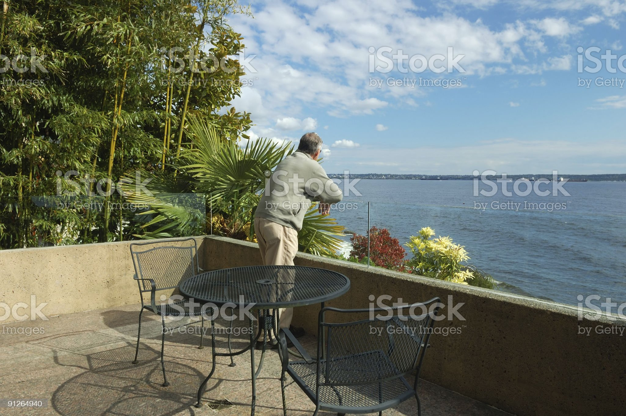 man standing on beach house patio royalty-free stock photo