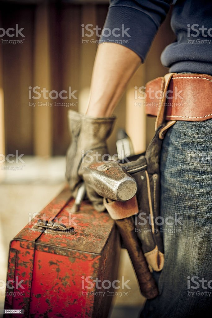 Man standing on construction site with tools stock photo