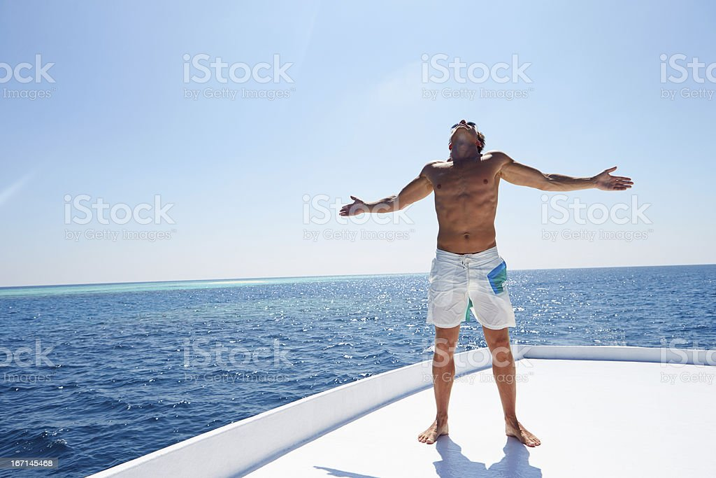 Man Standing On Deck Of Boat stock photo