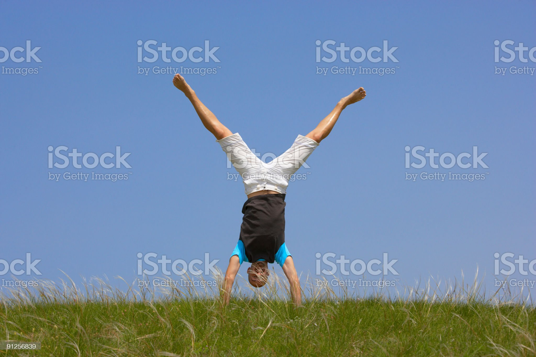 man standing on his hands royalty-free stock photo