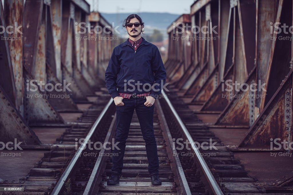 Man standing on railway stock photo