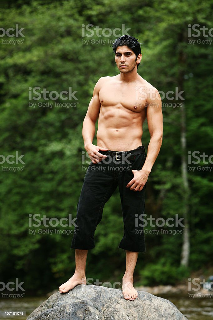 Man Standing on Rock Outdoors Portrait royalty-free stock photo