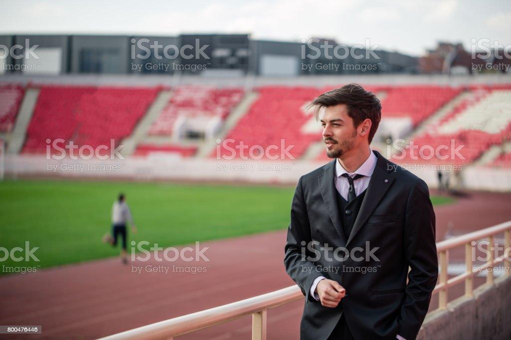 Man standing on sport stadium stock photo